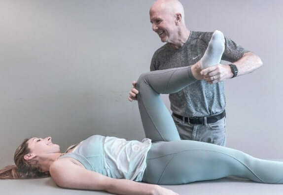 Physical Therapist doing Muscle Activation Techniques on a Woman